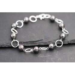 Armband mit Ringen und...